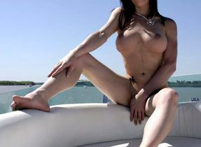 Busty Brunette TGirl Naked On Boat