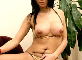 Busty Latina Tranny Spreads Long Legs